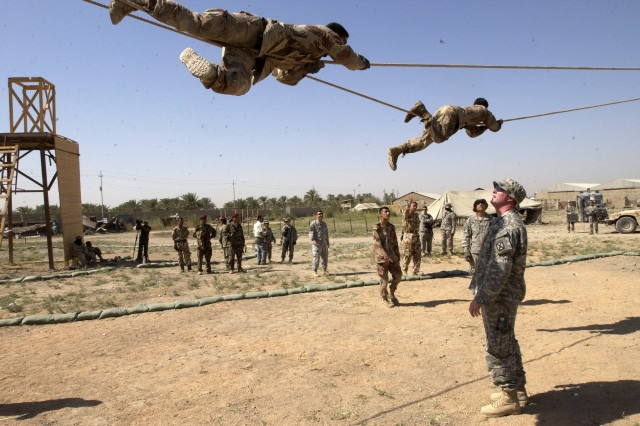 Spc. James Buron watches trainees negotiate the slide-for-life.