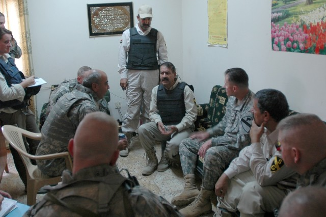 Maj. Gen. Joseph F. Fil Jr., commanding general of the Multi-National Division - Baghdad and the 1st Cavalry Division, meets with the head of security volunteers Saydiyah, Mohammed Hassen, at a security coordination center in the southern Baghdad neighborhood Oct. 6.
