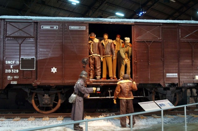 """A boxcar on display at the Air Power Gallery at the National Museum of the U.S. Air Force in Dayton, Ohio. Each boxcar carried 40 """"Doughboys"""" or eight horses to the front in France during World War I. During World War II when Germany occupied France, each of these boxcars carried up to 90 allied prisoners to German POW camps. Others carried Holocaust victims to concentration camps."""
