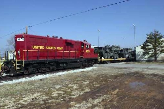 A U.S. Army locomotive moves loaded rail cars carrying equipment from the 957 Multi-Role Bridge Company, North Dakota Army National Guard for loading and transportation to an ocean port for shipment overseas, March 15, 2003. Upon completion of training the 957 deployed overseas to fight the war on terror.