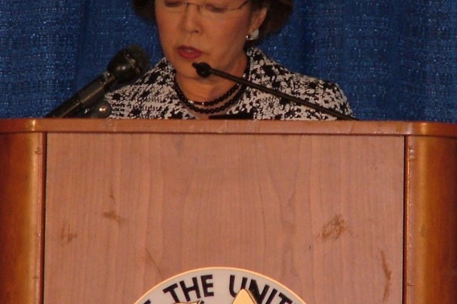 Patty Shinseki, wife of retired Gen. Eric Shinseki, former Army chief of staff, speaks about the welfare of military children during the second Family Forum at the Association of the United States Army Annual Meeting Oct. 9.