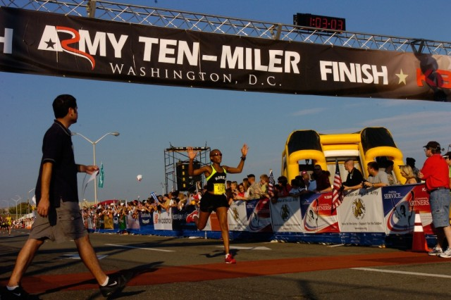 Angela Jackson- Angela Jackson crosses the finish line at the 23rd Annual Army Ten-Miler in Washington D.C October 7. Jackson finished the race in one hour three minutes and three seconds and placed 12th in the women's overall field in which 7,448 women competed.