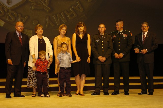 Gen (retired) Gordon Sullivan stands with Holly Chavez, her children, and her husband Lt. Col John Chavez as the family was recognized as the AUSA Rubbermaid-Irwin Volunteer Family of the Year at the D.C. Convention Center during 2007 Association of the United States Army Annual Convention. Volunteer Family of the Year at the AUSA convention. The family won the award for its many hours of community service, even 3-year old Nicholas and 5-year old Sebastian contributed by frequently visiting a senior living facility near Osan Airbase Korea. Lt. Col Chavez was assigned to 1st Battalion, 43rd Artillery when the family put in the many hours of service to the community. The family has since moved to Fort Bliss, Texas.