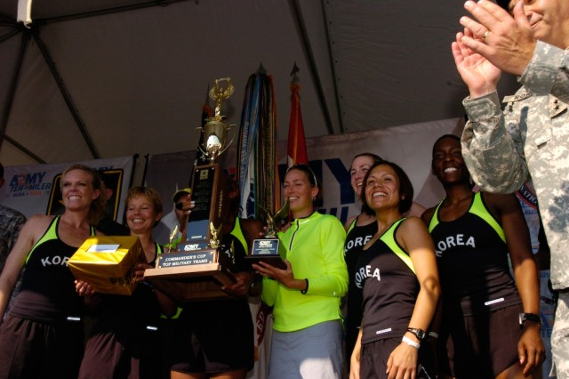 The 8th U.S. Army women's team members accept their trophies at an award ceremony held after the 23rd Annual Army Ten-Miler in Washington D.C. October 8. The women's team came in first for active duty women's team during the Army Ten-Miler