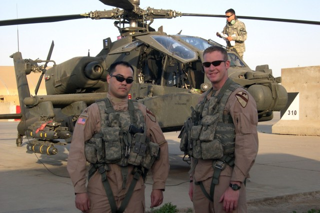 """Chief warrant officers 3 Eric Dillman (left) and Zachary Johnson are assigned to Company B, 4th """"Guns"""" Battalion, 227th Aviation Regiment, 1st Air Cavalry Brigade, 1st Cavalry Division. The two have been assigned to the same units since Basic"""
