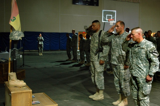 Soldiers render final salutes to Staff Sgt. Donnie Dixon, a Soldier with Headquarters and Headquarters Troop, after his memorial service at Forward Operating Base Warhorse, Baqouba, Iraq, Oct. 10.