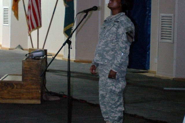 A Soldier with the 3rd Brigade Combat Team, 1st Cavalry Division, sings a song of remembrance during a memorial service for Staff Sgt. Donnie Dixon, a Soldier with Headquarters and Headquarters Troop, at Forward Operating Base Warhorse, Baqouba, Iraq, Oct. 10.