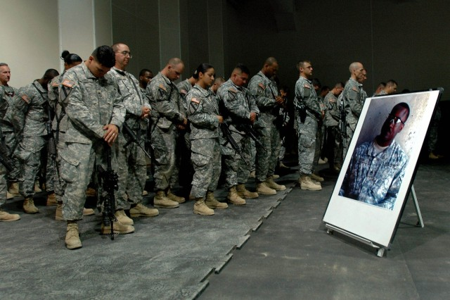 Soldiers of 3rd Brigade Combat Team, 1st Cavalry Division, remember the life and sacrifice of Staff Sgt. Donnie Dixon, a member of Headquarters and Headquarters Troop, during his memorial service at Forward Operating Base Warhorse, Baqouba, Iraq, Oct. 10.