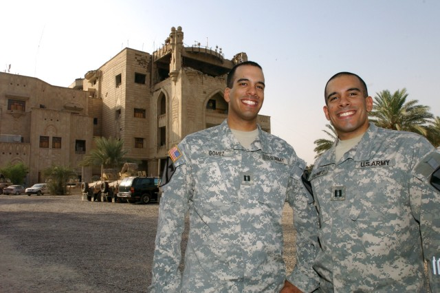 Capts. Richard (left) and Daniel Gomez pose for a picture in front of the Forward Operating Base Prosperity's palace.