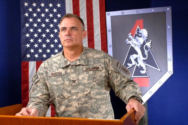 """Col. J.B. Burton, commander of the 2nd """"Dagger"""" Brigade Combat Team, 1st Infantry Division, conducts a press briefing via satellite with the Pentagon press corps from Camp Victory in western Baghdad Oct. 12, reporting that violence there has"""