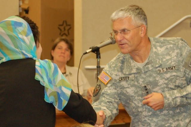 Gen. George Casey greets Mrs. Khatol Wardak, the wife of Gen. Abdul Rahim Wardak, defense minister of Afghanistan, at his meeting with family readiness group assistants at Fort Campbell Friday.