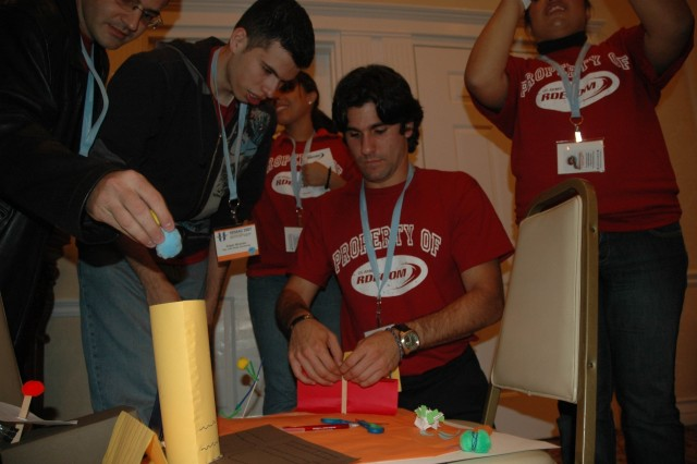 Gabriel Eslait and Edgar Miranda, RDECOM student team members, work with the RDECOM team to finish a project challenge Oct. 12 during the 8th Annual HENAAC College Bowl Competition in San Diego, Calif.