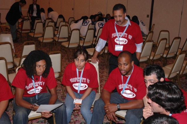 Kashia Simmons and Angel Rodriguez, RDECOM College Bowl Coaches, facilitate a group challenge with RDECOM's student team during the 8th Annual HENAAC College Bowl Competition Oct. 12 in San Diego, Calif.