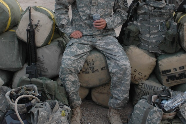 Sgt. Justin Garza, 15th Brigade Troops Battalion, 15th SB, waits for his final flight out of Camp Taji 13 Oct.  The Harker Heights, Texas native spent 15 months deployed with the 'Wagonmasters'; three months longer than the brigade anticipated.  Garza and fellow 15th SB Soldiers are some of the first 1st Cavalry Division troops to return to Fort Hood from Iraq.