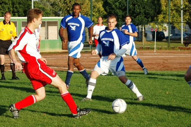 A Landtag-Elf player tries to push the ball through Wiesbaden Eagles defenders during the Second Annual German-American Soccer Friendship Game Sept. 18 at Wiesbaden Army Airfield.