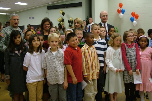 Chief of Staff of the Army Gen. George W. Casey, Jr. and Secretary of the Army Pete Geren pose with local fourth-grade students after signing the Army Family Covenant in Fort Knox, Ky. The covenant pledges to improve education and childcare for Army Families.