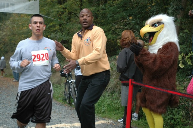 Charles Stevenson, U.S. Army Garrison Darmstadt Sports, and the American Forces Network Europe Eagle greet finishers at Frankenstein Castle Run.