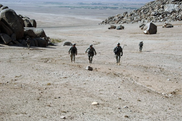 Soldiers from Company B, 2nd Battalion, 508th Parachute Infantry Regiment, search for Taliban in Waghez, Afghanistan, Sept. 19.