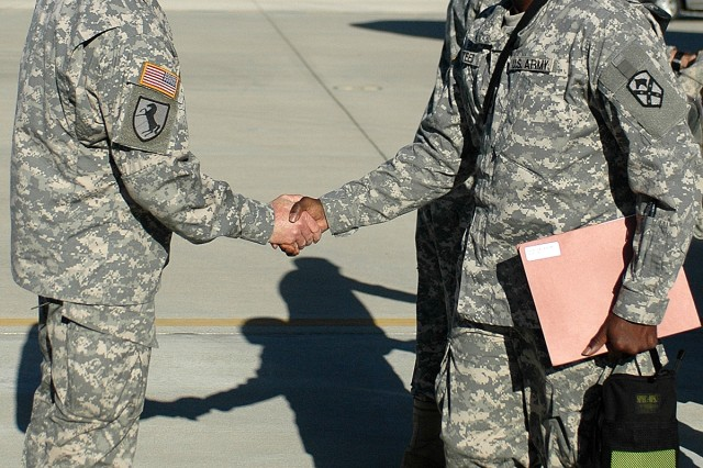 Sergeant Major of the Army Kenneth Preston, a native of Mount Savage, Md., and the Army's senior noncommissioned officer, welcomes home Charleston, S.C., native Sgt. 1st Class Carl Steed, the senior food service noncommissioned officer for the 15th Sustainment Brigade's Brigade Troops Battalion, at Fort Hood's Robert Gray Army Airfield Oct. 18.
