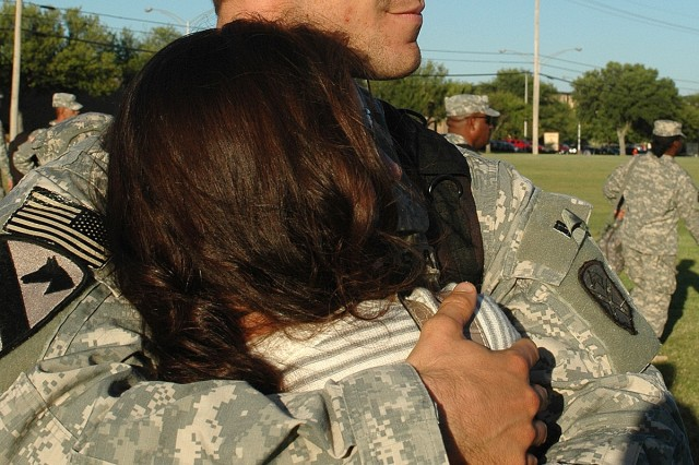 Capt. Travis Brown, a native of Fayetteville, Tenn., and the battalion logistics officer for the Brigade Troops Battalion, 15th Sustainment Brigade, 1st Cavalry Division, hugs his wife, Amy, who hails from White Bluff, Tenn., following a homecoming ceremony Oct. 18 at the division's parade ground, Cooper Field, at Fort Hood, Texas.