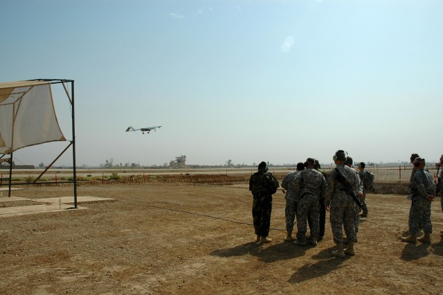 """A crowd looks on as they watch the first-ever launch of an unmanned aerial vehicle by an Iraqi. Iraqi Army Lt. Gen. Abud Qanbar, the commanding general of Baghdad Operational Command, launched the Shadow UAV during his visit with the leaders of the 1st Air Cavalry Brigade, 1st Cavalry Division, Oct. 14 at Camp Taji, Iraq. The UAV unit, Company E, 615th Aviation Support """"Cold Steel"""" Battalion, covers all of the Multi-National Division-Baghdad area of operations."""