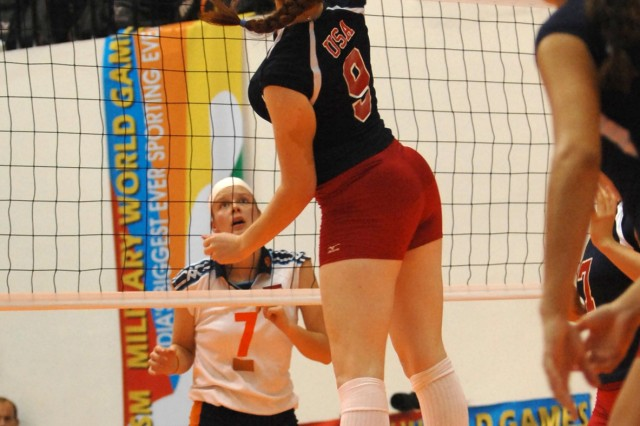 Spc. Sarah Lusk goes up for a spike during a match against the Netherlands.