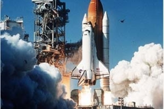Discovery takes off on a previous mission.