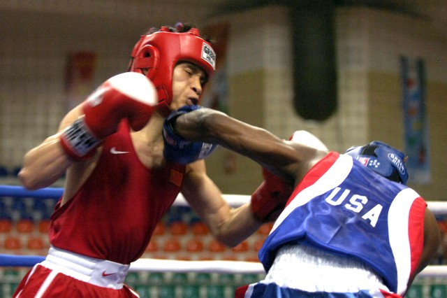Army Sgt. John Franklin left hooks Cadet Gao Linzhi from China in the boxing event.