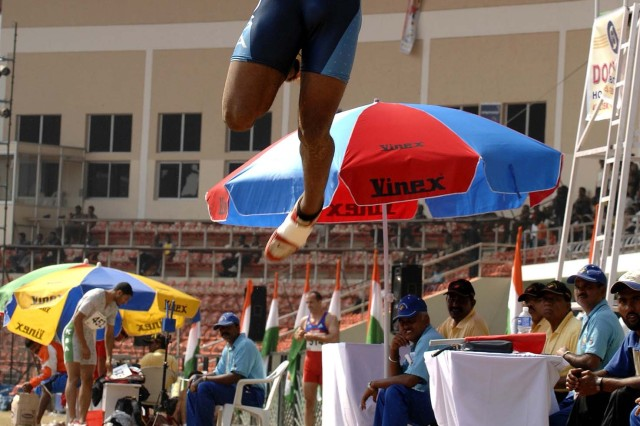 Army Pfc. Francois Gatson leaps during the long jump event.