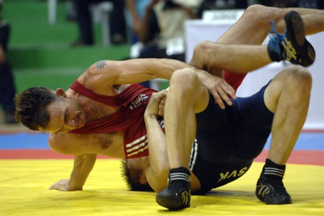 Army Staff Sgt. Glenn Garrison wrestles Dujan Babrnak, from Slovakia, in the Men's 66 kg weight category during the Free Style Wrestling Tournament.