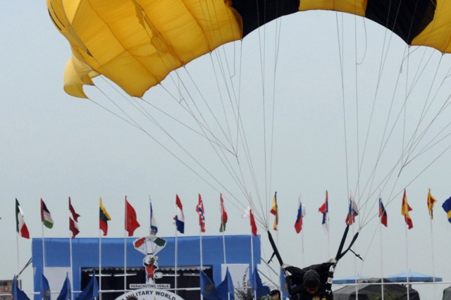 Army Staff Sgt. Norma Estrella performs an accuracy jump over Hakimpt Air Force Station in the parachuting competition.