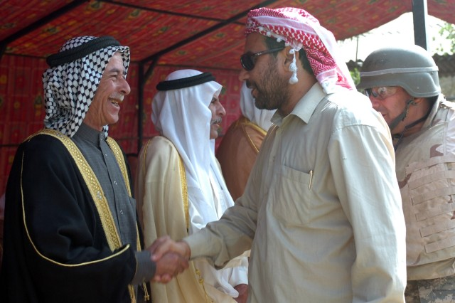 Sunni and Shia tribal sheiks greet each other at the opening of the Sheiks Conference Center near Taji, Iraq Oct. 18.  The center is neutral ground for sheiks of all tribes to gather and reconcile.  The center was christened with a meeting and ended with everyone feasting together.