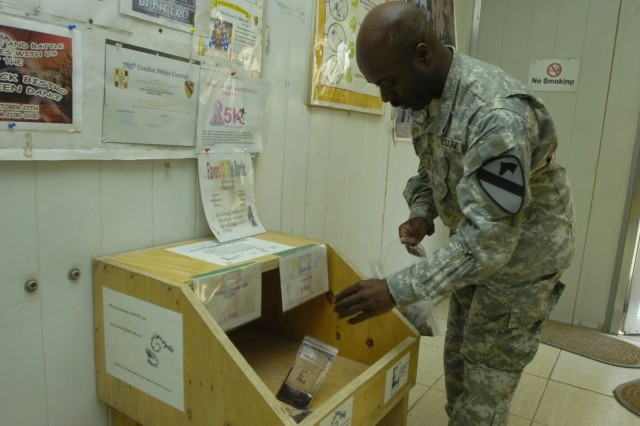 Chief Warrant Officer Tilden Morgan, an electronic missile systems technician with the 15th Brigade Support Battalion, 2nd Brigade Combat Team, 1st Cavalry Division, fills a box with coffee samples at the Black Jack Bistro at Forward Operating Base Prosperity in central Baghdad. Every couple of days Morgan, puts out the free samples, which are donated by his shop in Killeen, Texas, Java Jolt, and Texas Coffee Traders.