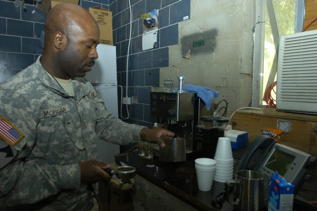 Chief Warrant Officer Tilden Morgan, an electronic missile systems technician with the 15th Brigade Support Battalion, 2nd Brigade Combat Team, 1st Cavalry Division, prepares a shot of espresso at his office at Forward Operating Base Prosperity in central Baghdad. Morgan and his wife own Java Jolt, a coffee shop located in Killeen, Texas.