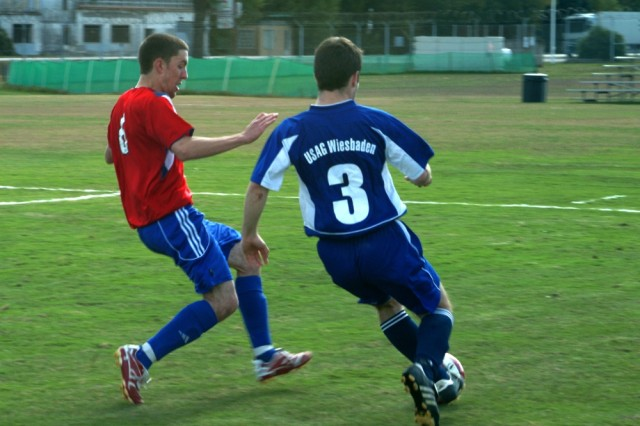 Wiesbaden's Kyle Horner, right, struggles to maintain control of the ball as Stuttgart's Ivan Nakoneczny goes in for the steal.