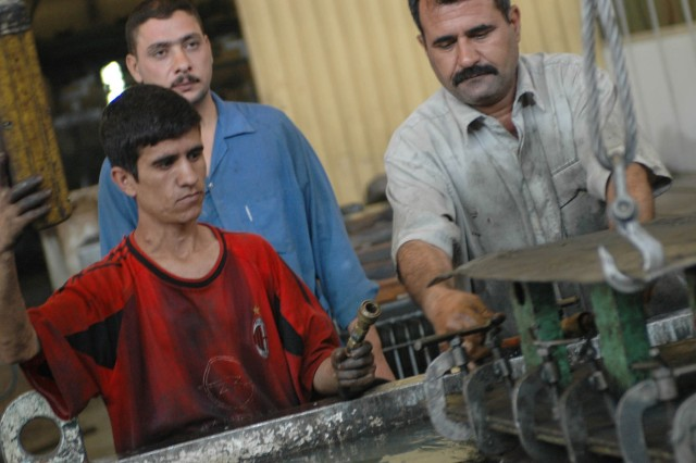 Local citizens from Diyala province assist in the assembly of transformers at a Diyala Electrical Industries factory located in Baqouba, Iraq, Oct. 22. Diyala Electric Industries, which has been operating at a limited capacity since 2003, now employs approximately 800 citizens from Baqouba and its surrounding villages.