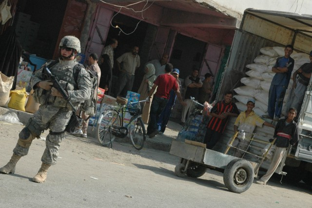 A Soldier from 1-12 Combined Arms Battalion, 3rd Brigade Combat Team, 1st Cavalry Division, conducts security during a patrol in the Old Baqouba market area in Baqouba, Iraq, Oct. 21. Prior to Operations Arrowhead Ripper and Lighting Hammer, the city was virtually shut down due to widespread fear of extremist organizations.