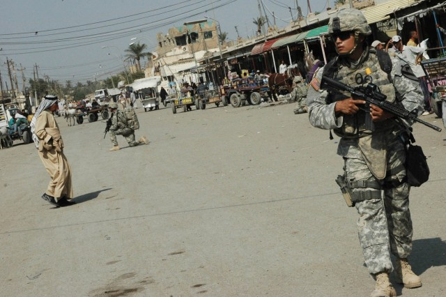 Spc. Jaime Martinez, a medic with the 3rd Brigade Combat Team, 1st Cavalry Division commander's personal security detachment, conducts a patrol through the Old Baqouba market in Baqouba, Iraq, Oct. 21. Prior to Operations Arrowhead Ripper and Lighting Hammer, the city was virtually shut down due to widespread fear of extremist organizations.