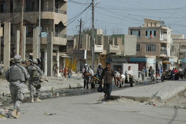 Soldiers from 1-12 Combined Arms Battalion, 3rd Brigade Combat Team, 1st Cavalry Division, patrol the Old Baqouba market in Baqouba, Iraq, Oct. 21. Prior to Operations Arrowhead Ripper and Lighting Hammer, the city was virtually shut down due to widespread fear of extremist organizations.