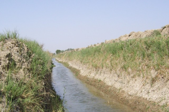 For the first time in more than four years, water now flows continuously through an irrigation canal (pictured above) near Fira Shia, Iraq that once had barely enough water for farmers to use for subsistence farming. The Fires Squadron, 2nd Stryker Cavalry Regiment teamed with local Sunni and Shia tribal leaders, local Iraqi government officials and the 1st Squadron, 7th Cavarly Regiment to solve the problem of getting an adequate amount of irrigation water in canals for the farmers in the Taji area to use prior to the winter planting season.