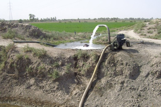 Water fills an irrigation canal near Fira Shia, Iraq. After uncovering a problem at a power substation, leadership in the Fires Squadron, 2nd Stryker Cavalry Regiment worked with local Sunni and Shia tribal leaders, local government officials and the 1st Squadron, 7th Cavalry Regiment to provide an adequate supply of water to assist local farmers with raising their crops.