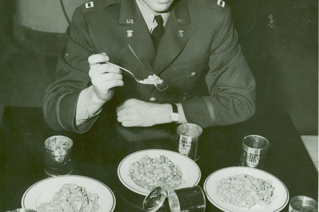 Captain A. A. Hall, Q.M.C. samples the Field Ration C at the Subsistence Research Laboratory, Chicago Quartermaster Depot, Chicago, IL, 1941. (Source: QM Food Rations Photograph Collection).