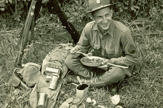 MSGT Victor Horwath, 174th Infantry, NYNG tests the Army's new Field Ration C during First Army's summer maneuvers, New York, 1940. (Source: QM Food Rations Photograph Collection).