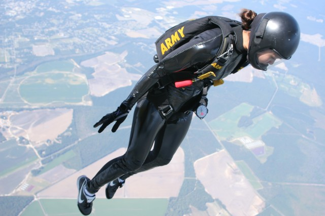 Staff Sgt. Norma Estrella, women's 4-way team member for the Golden Knights, practices exiting the aircraft for the 4th Military World Games.