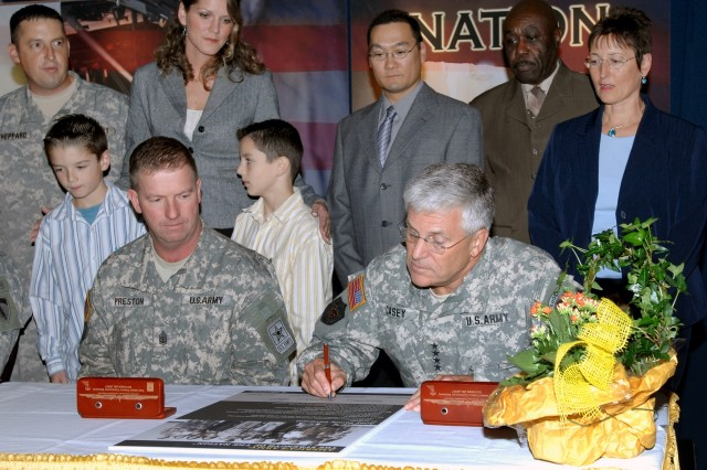 Army Chief of Staff Gen. George W. Casey Jr. signs the Army Family Covenant in a ceremony on Campbell Barracks in Heidelberg, Germany Oct. 26. Sgt. Maj. of the Army Kenneth O. Preston (left) also signed the document, along with U.S. Army Europe leaders.