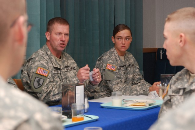 Sgt. Maj. of the Army Kenneth O. Preston discusses Army training and standards with Soldiers of U.S. Army Europe's 529th Military Police Company during a breakfast meeting with the MPs in Heidelberg, Germany Oct. 26. The breakfast was one of several meetings on Preston's whirlwind nine-day itinerary spanning U.S. Army Europe.