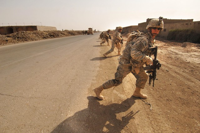 Soldiers move tactically during the search.
