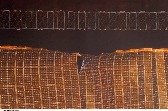 A view of a damaged Port 6 4B solar array wing on the International Space Station. NASA halted the deployment -- which is about 80 percent complete -- to evaluate the damage.