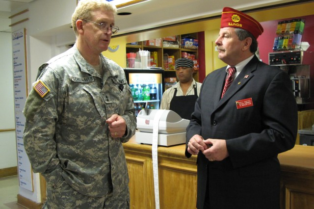 Maj. Gen. Eric B. Schoomaker, North Atlantic Regional Medical Command and Walter Reed Army Medical Center commander, speaks with American Legion Commander Martin F. Conatser during his visit to WRAMC Oct. 24.