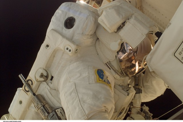 Army astronaut Col. Doug Wheelock, STS-120 mission specialist, on his first spacewalk to perform work on the International Space Station. During his third spacewalk on Saturday, he and mission specialist Scott Parazynski will attempt to repair a torn solar array in the Port 6 truss.